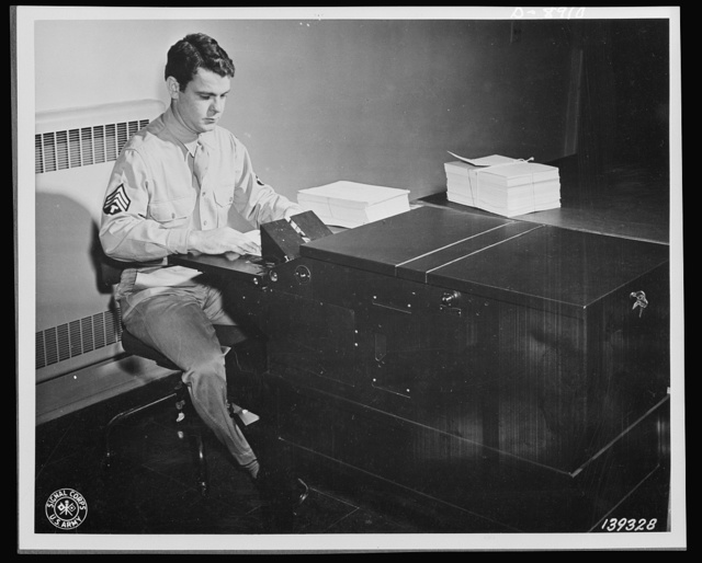 V-mail. Letters to members of the armed forces overseas are photographed on V-mail microfilm at the Pentagon building, Washington, D.C.  V-mail is available to and from the armed forces stationed outside the United States. It is only 1/65th the weight of ordinary mail and saves ninety-eight percent of the cargo space required for ordinary letters. 1,600 letters can be placed on a roll of film little larger than a pack of cigarettes