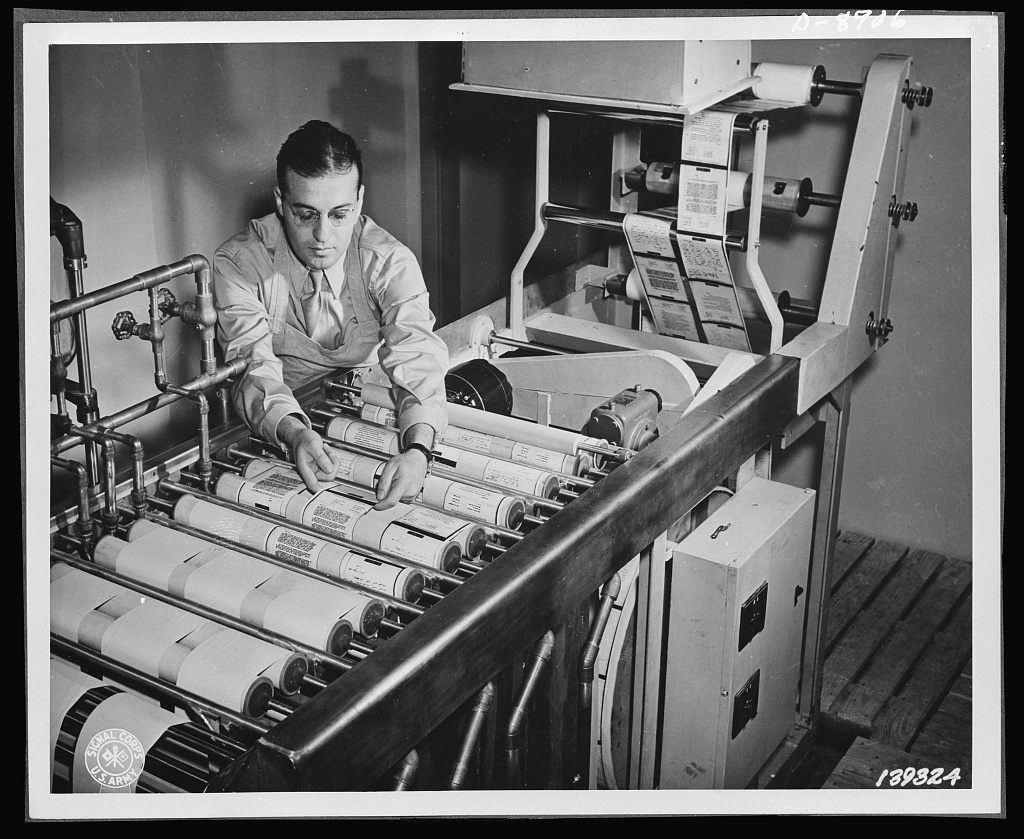 V-mail. Paper reproductions from V-mail microfilm are developed, fixed washed and dried on a continuous paper processing machine at the Pentagon building, Washington, D.C.  V-mail is available to and from the armed forces stationed outside the United States. It is only 1/65th the weight of ordinary mail and saves ninety-eight percent of the cargo space required for ordinary letters. 1,600 letters can be placed on a roll of film little larger than a pack of cigarettes
