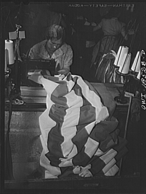 Verona, New Jersey. Sewing stripes on an American flag at the Annin Flag Company