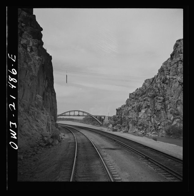 "Victorville (vicinity), California. Going through the ""narrows"" on the Atchison, Topeka and Santa Fe Railroad between Barstow and San Bernardina, California"