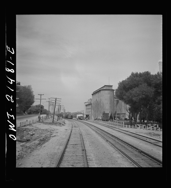 Victorville (vicinity), California. Passing a Portland cement plant along the Atchison, Topeka and Santa Fe Railroad between Barstow and San Bernardino, California