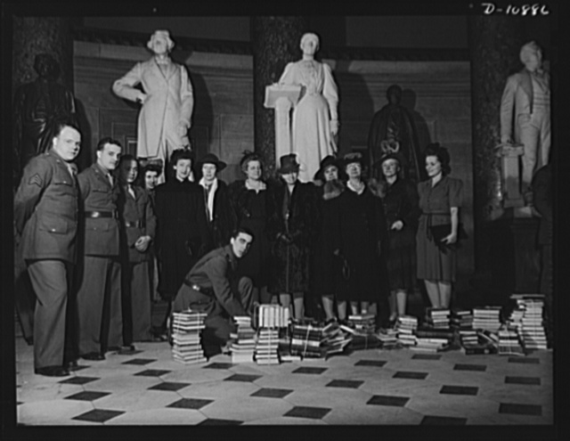 Victory Book Campaign. Soldiers of Fort Myer, Virginia and ladies of the Red Cross at Staturary Hall in the Capitol at ceremonies at which members of Congress contributed books for the 1943 Victory Book Campaign