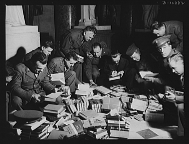 Victory Book Campaign. Soldiers of Fort Myer, Virginia, in Statuary Hall of the Capitol, receiving books donated by members of Congress for 1943 Victory Book Campaign