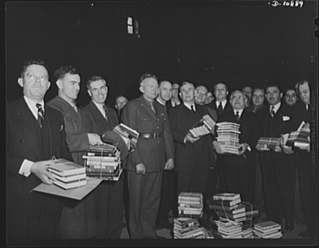 Victory Book Campaign. Vice-President Henry A. Wallace and members of Congress donate books to the armed forces for the 1942 Victory Book Campaign. Holding books are (left to right): Sergeant Dale Isley of Fort Myer, Virginia; Mr. Wallace; Senator Alben Barkley of Kentucky; and Representative Adolph Sabath of Illinois. The soldier in the center is Corporal Frank York of Fort Myer, Virginia