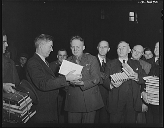 Victory Book Campaign. Vice-President Henry A. Wallace donating victory books to Corporal Frank York of Fort Myer, Virginia while Senator Lister Hill of Alabama looks on in ceremonies in Statuary Hall at the Capitol