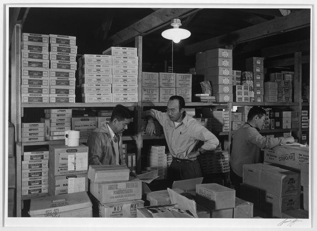 Warehouse, M. Ogi, manager; S. Sugimoto, manager of Co-op; Bunkichi Hayashi, Manzanar Relocation Center / photograph by Ansel Adams.