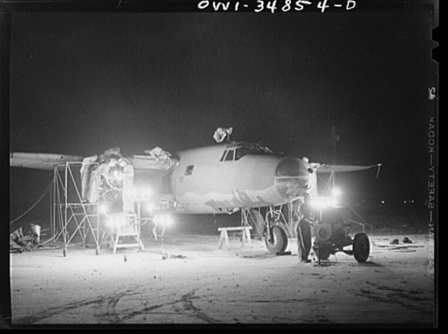 Warner Robins, Georgia. Air Service Command, Robins Field. Men of an air depot group working on a B-26 bomber at night