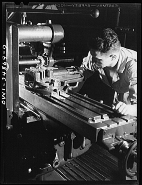 Warner Robins, Georgia. Air Service Command, Robins Field. Milling machine operator in one of the machine shops of an air depot group
