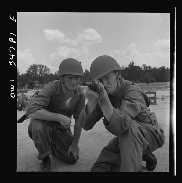 Warner Robins, Georgia. Air Service Command, Robins Field. Private Walter F. Guthrie, of Canadian, Texas, learning to handle a carbine. The instructor is Sergeant Dennis Maloney of Brooklyn, New York. Guthrie was a filling station operator in his home town; Maloney, a clerk in an A&P store. Both are now members of a depot group