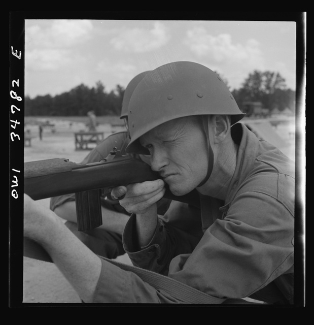 Warner Robins, Georgia. Air Service Command, Robins Field. Private Walter F. Guthrie learning marksmanship with a carbine. In civilian life he was a gas station operator in Canadian, Texas