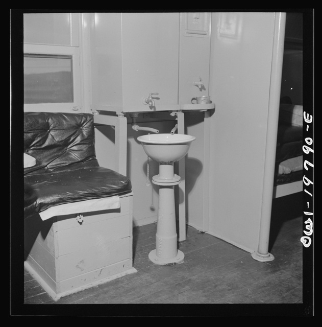 Washbasin in a caboose on the Atchison, Topeka, and Santa Fe Railroad between Argentine and Emporia, Kansas. Spigot on the right is for drinking water; the one on the left is for wash water