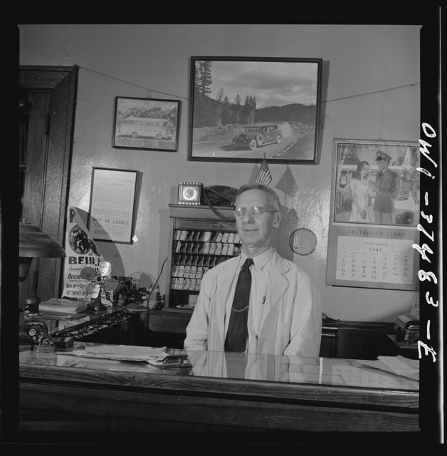 Washington Court House, Ohio. A ticket agent at a small bus station