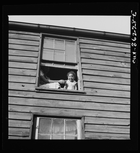 Washington, D.C. A child in her home, which is an alley dwelling near the capitol