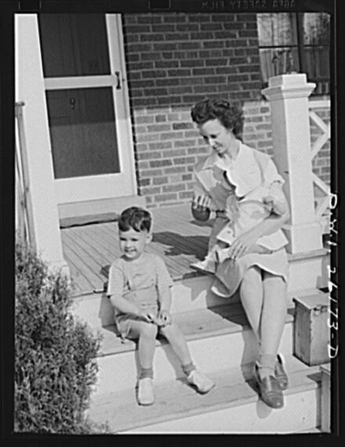 Washington, D.C. A day nursery for pre-school children of mothers engaged in war work, operated under the supervision of the District of Columbia Health Department by Mrs. Leroy Bonbrest, at her home at 1144 Branch Avenue, S.E. A child leaving the nursery