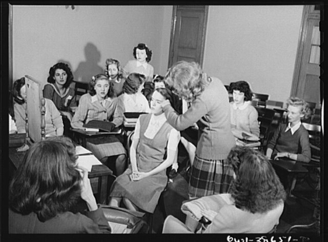 Washington, D.C. A demonstration of correct procedure in applying street makeup in a home management class at Woodrow Wilson High School