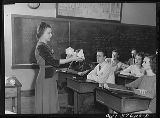 Washington, D.C. A geometry teachers at Woodrow Wilson High School using a model to explain a figure