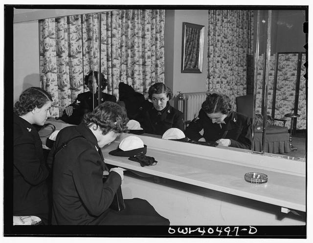 Washington, D.C. A group of WAVES (Women Accepted for Volunteer Emergency Service), just off a train, freshen up in the powder room at the United Nations service center