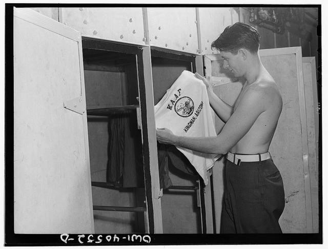 Washington, D.C. A soldier in the laundry at the United Nations service center taking his shirt out of the electric dryer which dries clothes in thirty minutes