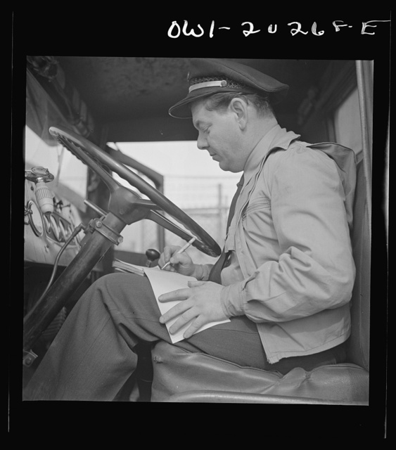 Washington, D.C. Bob Daugherty filling out his log book after lunch. The United States Interstate Commerce Commission requires all truck drivers to keep time record