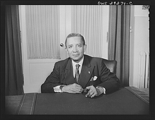 Washington, D.C. Edwin Barclay, President of the Republic of Liberia, is shown at a desk in historic Blair House following a press conference at the United States State Department