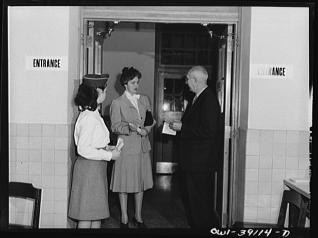 Washington, D.C. Faculty member and students assisting ration book applicants at Woodrow Wilson High School