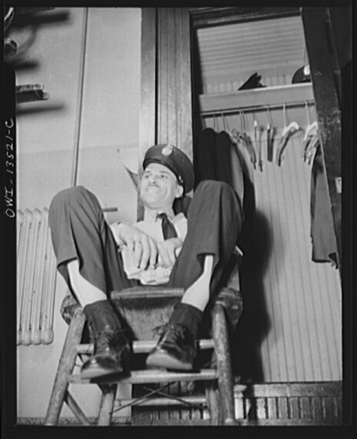 Washington, D.C. Firehouse Station No. 4. Fireman sitting with his shoes untied so that in case of alarm he can shake them off easily and jump into his boots