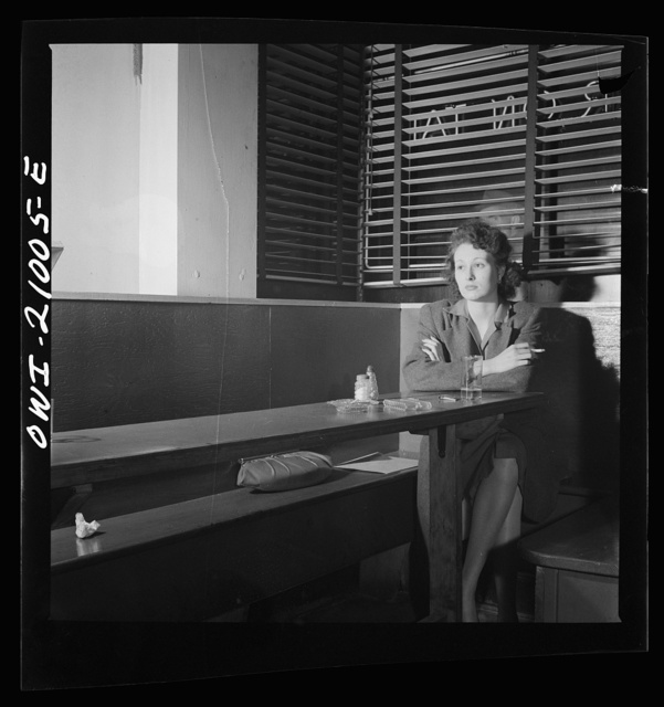"Washington, D.C. Girl sitting alone in the Sea Grill, a bar and restaurant waiting for a pickup. ""I come in here pretty often, sometimes alone, mostly with another girl, we drink beer, and talk, and of course we keep our eyes open--you'd be surprised at how often nice, lonesome soldiers ask Sue, the waitress, to introduce them to us"""