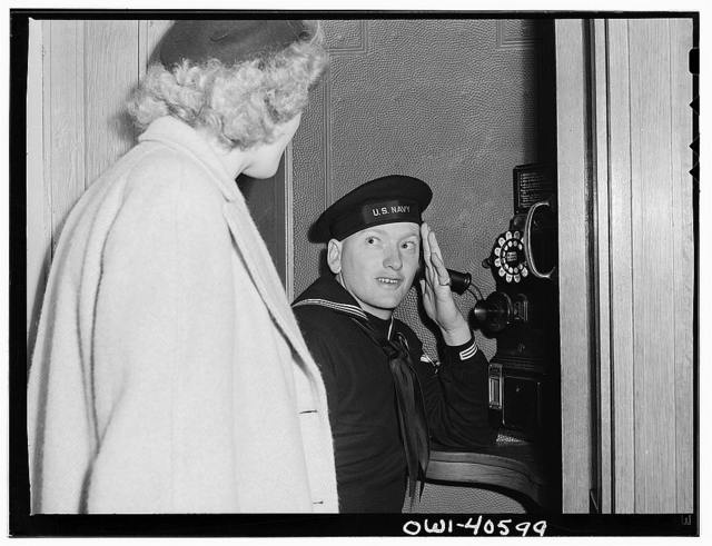 Washington, D.C. Hugh Massman makes a phone call to the United Nations Service Center nursery to check up on the behavior of his young son, who is being taken care of for the afternoon