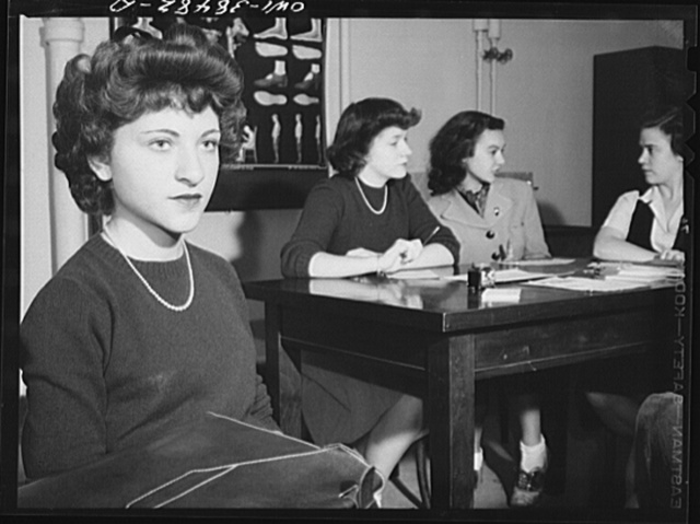 Washington, D.C. In a health education class, students in turn submit their personality problems to a panel, which leads a class discussion. The girl in the foreground is the subject of discussion. Woodrow Wilson High School