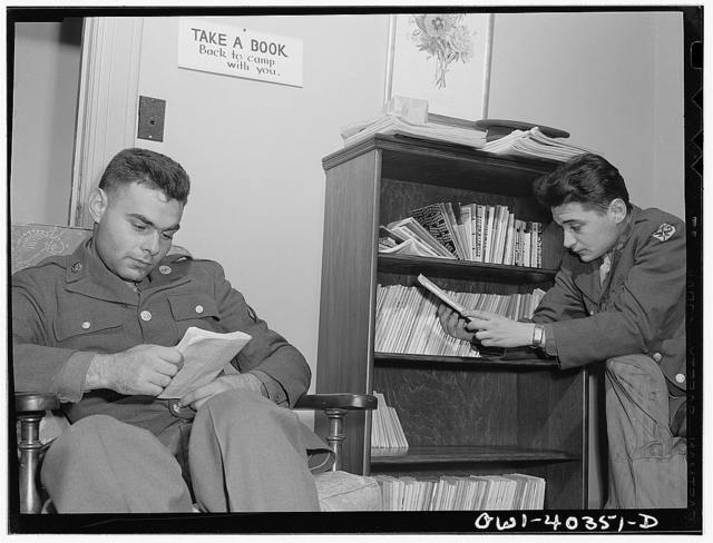 Washington, D.C. In the library at the United Nations service center. Boys are urged to take books back to camp with them