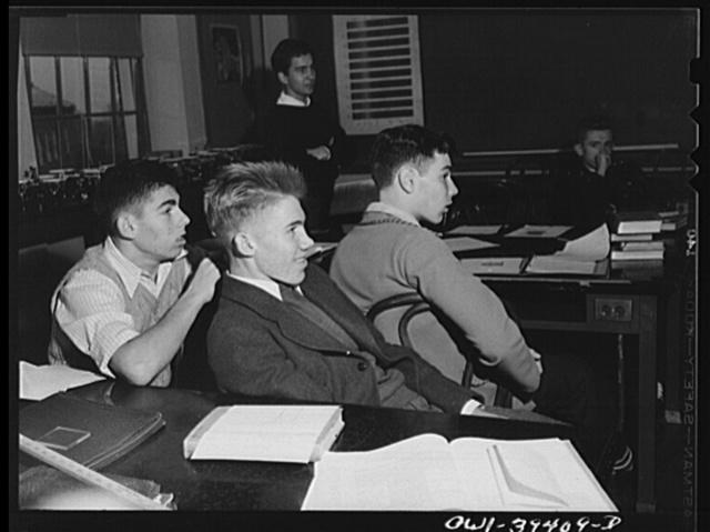 Washington, D.C. Listening to an explanation by the teacher in physics class at Woodrow Wilson High School