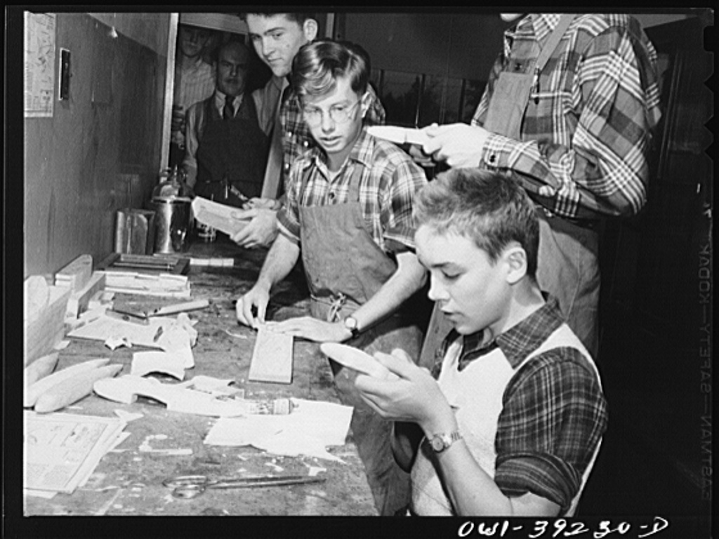 Washington, D.C. Members of a wood-making class at Woodrow Wilson High School making model planes for use by the U.S. Navy