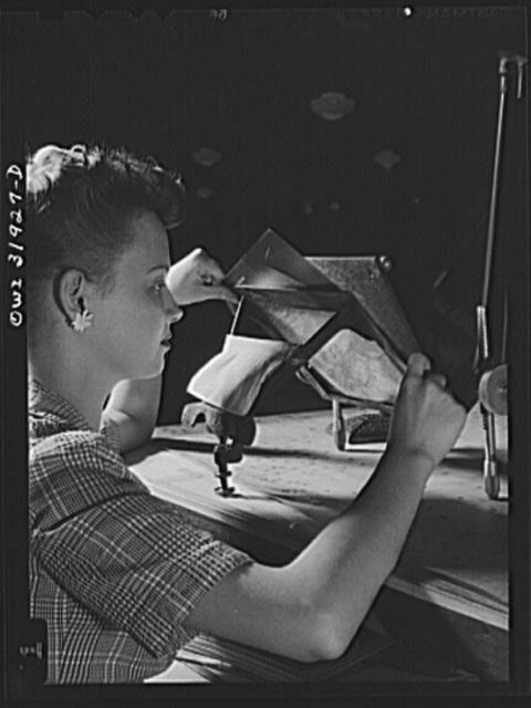 Washington, D.C. Miss Alice Blackwell, an employee of the U.S. Geological Survey, Alaska branch, is inserting an oblique aerial photograph into the oblique sketch master for the purpose of transferring the planimetry from the photograph to the base map of the manuscript
