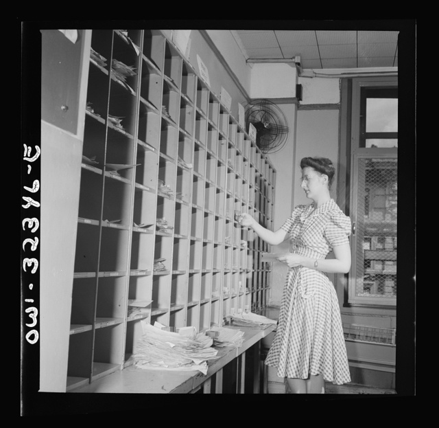Washington, D.C. Miss Jane Anderson filling telegrams at the Western Union telegraph office