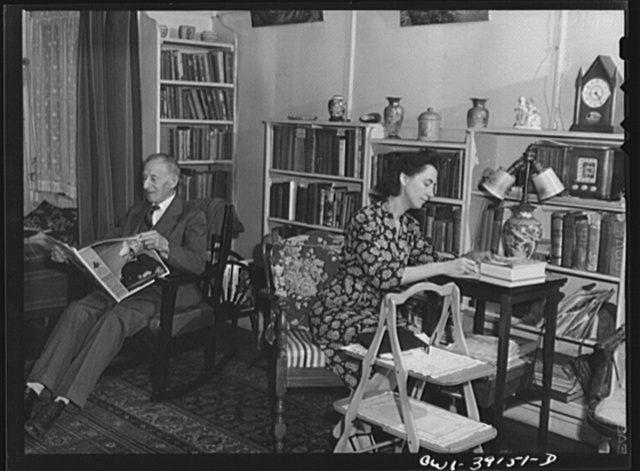 Washington, D.C. Miss Norma Kale, Woodrow Wilson High School English instructor, correcting papers at her home in the evening