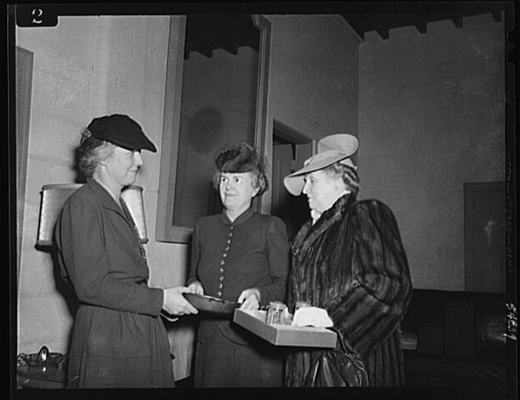 Washington, D.C. Mrs. James M. Landis, Mrs. Henry Wallace, and Mrs. Jesse Jones admiring gifts at the kitchen shower at the Walsh Club for war workers