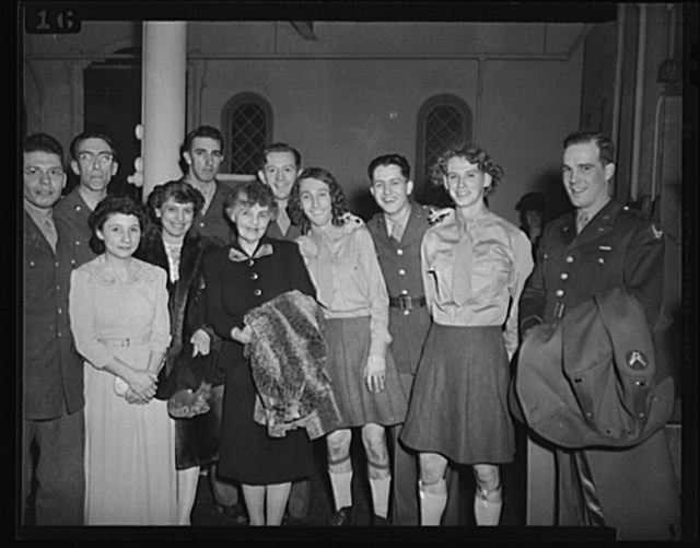 Washington, D.C. Mrs. Stuart Godfrey, chairman of music for the services, and members of the cast of the Bolling Field show after their performance at the kitchen shower of the Walsh Club for war workers. Left to right: Corporal Virgil Fox, noted organist and pianist; Corporal Don Benjamin, director of the show; Miss Betty Baum, concert singer; Mrs. Marion McGregor, in charge of publicity for music for the services; Sergeant Bob Shortmeyer; Mrs. Stuart Godfrey; Sergeant Jack Knuppel; Corporal