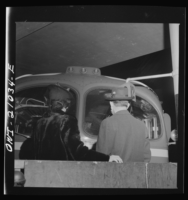 Washington, D.C. Parents of one of the soldiers on a special bus, climbing onto the baggage cart to look into the bus until the moment it departs from the Greyhound terminal