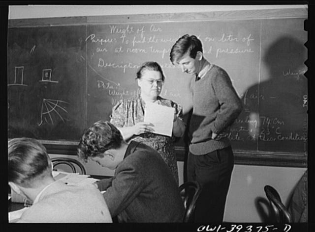 Washington, D.C. Physics teacher at Woodrow Wilson High School explaining a problem to one of her students