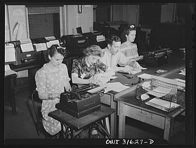 Washington, D.C. Preparing an advisory forecast at the U.S. Weather Bureau. Weather forecasts and advices are coded for transmission to military and civilian centers for war activity