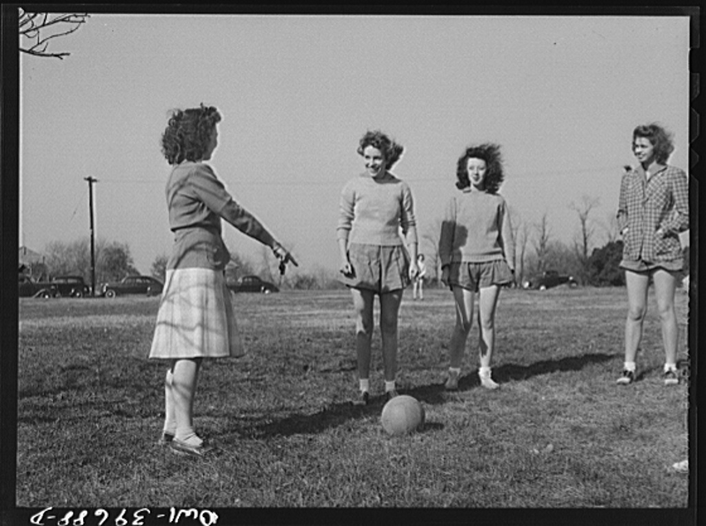 Washington, D.C. Sally Dessez, a student at Woodrow Wilson High School, listening to the gymnasium teacher give instructions for putting the ball in play in a speedball game