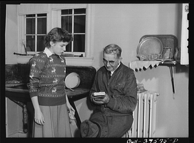 Washington, D.C. Sally Dessez, a student at Woodrow Wilson High School, orders vegetables from the huckster as one of her tasks at home