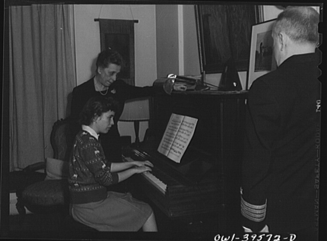 Washington, D.C. Sally Dessez, a student at Woodrow Wilson High School, playing the piano as her father and aunt listen