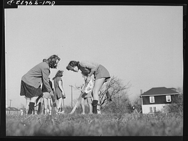 Washington, D.C. Sally Dessez (in shorts), a student at Woodrow Wilson High School, practicing before going into a hockey game