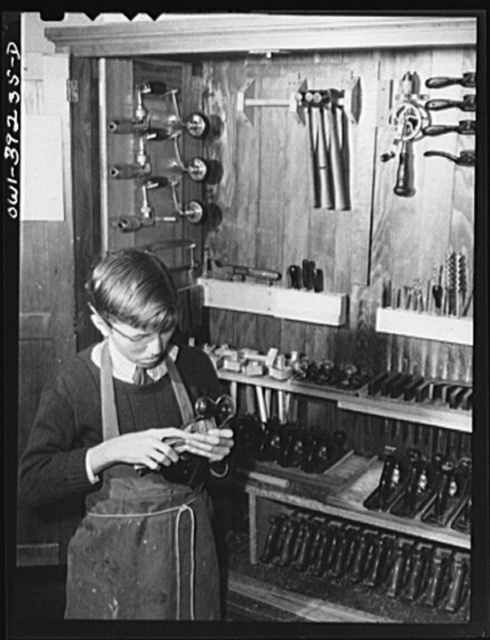 Washington, D.C. Selecting a plane from the tool cabinet in the wood shop