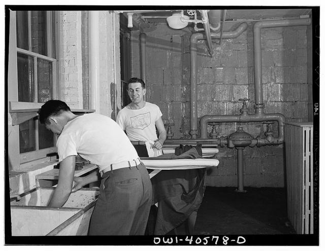 Washington, D.C. Servicemen using the laundry facilities in the sub-basement of the United Nations service center. It is not necessary to engage a hotel room in order to use these accomodations