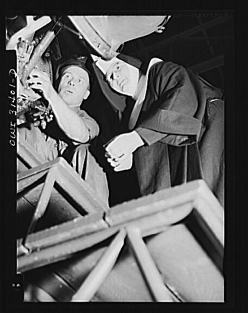"Washington, D.C. Sister Aquinas, ""flying nun,"" exchanging trade secrets with an engineer at the Washington National Airport"