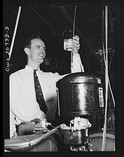 Washington, D.C. Testing substitute gasoline and measuring the degree of wear which it produces on an automobile engine cylinder at the U.S. Bureau of Standards