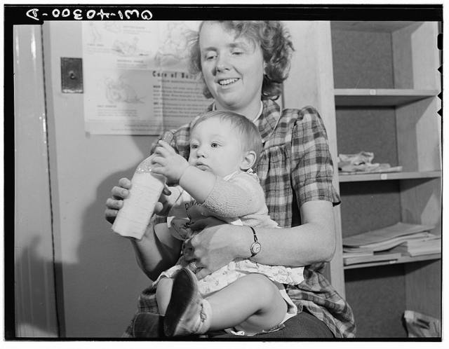 Washington, D.C. The child of a United States Army officer being cared for in the nursery at the United Nations service center while her parents spend the day shopping