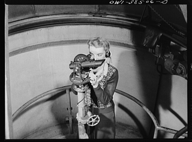 Washington, D.C. The U.S. Weather Bureau station at the National Airport. Following the course of a pilot balloon through the atmosphere with a theodolite instrument which measures the position